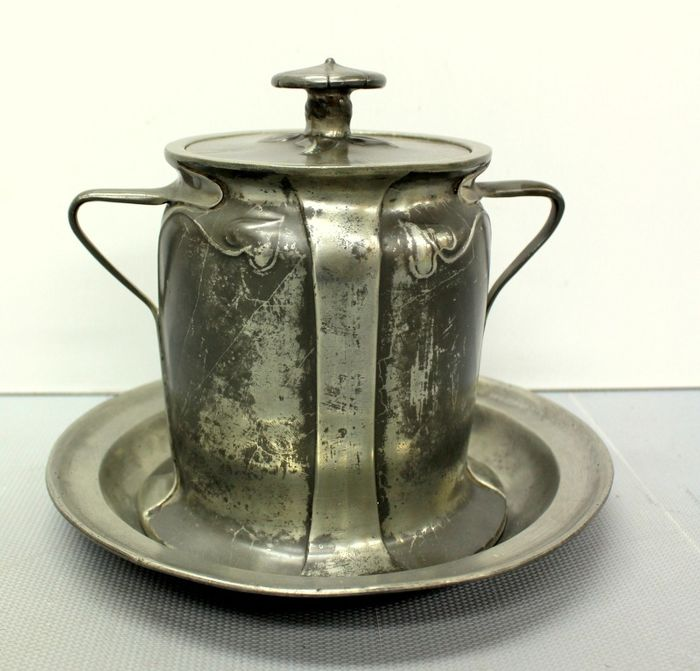 Antique lid pot on a scale - Tin