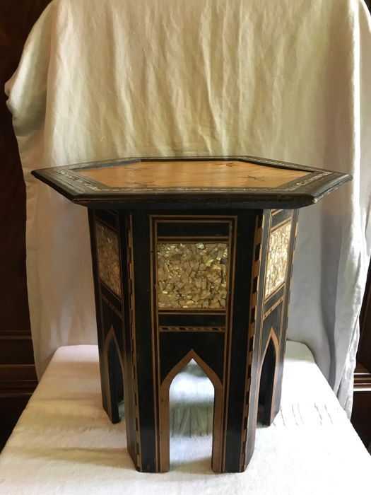 A six-angled side table with inlays in contrasting woods and mother-of-pearl