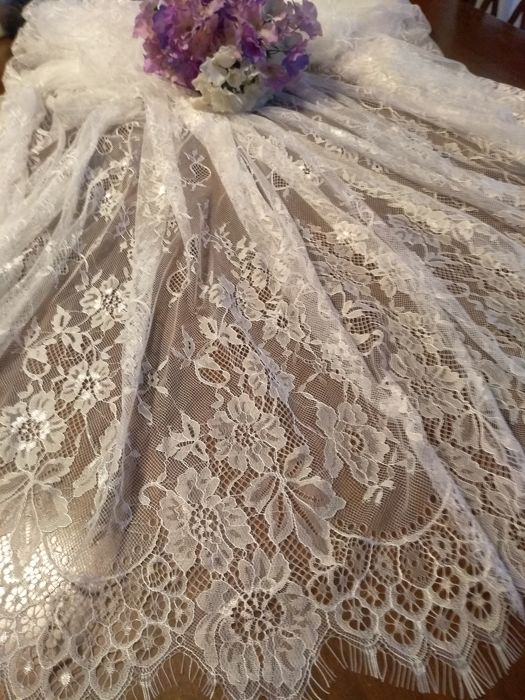 White floral lace tablecloth.