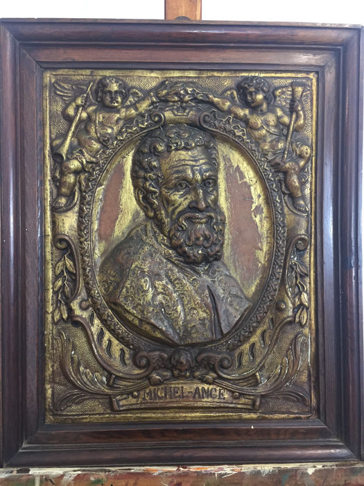 Portrait of Michelangelo Buonarroti. Bas-relief in a frame