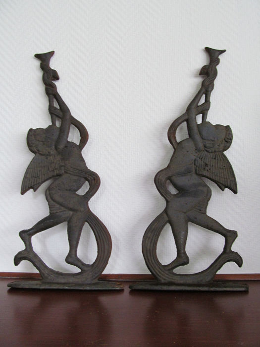 2 Cast-iron ornaments Angels with trumpet - Cast iron