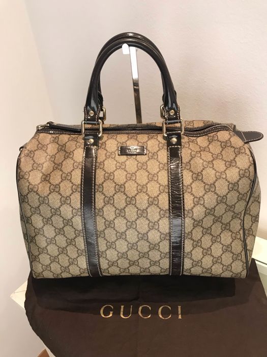 19ba5d9168a4af Gucci - GG Coated Canvas Medium Joy Boston Handbag - Catawiki