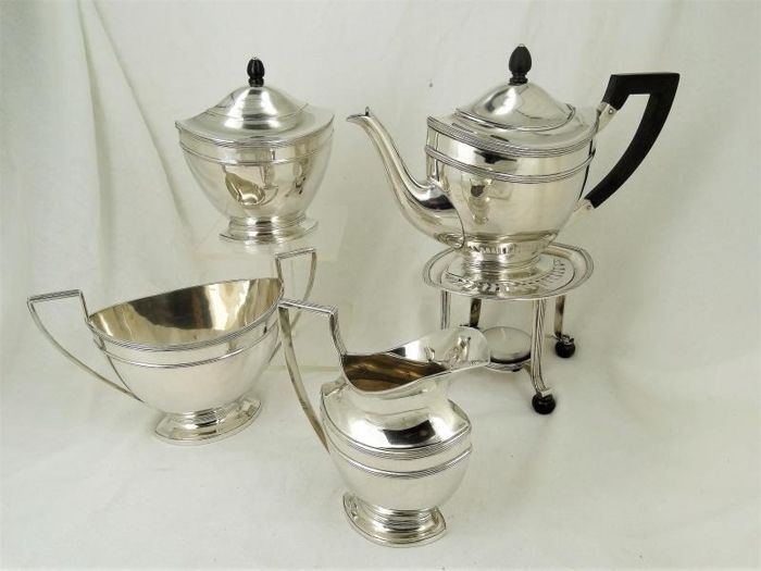 5-part tea set on a stove - .833 silver - Netherlands - Early 20th century