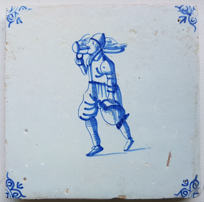 Antique tile man with jug and something on his shoulder rare! (1) - Earthenware