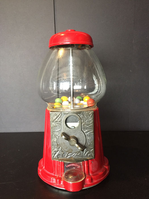 Money-operated cast iron Gumball gumball machine with glass dome