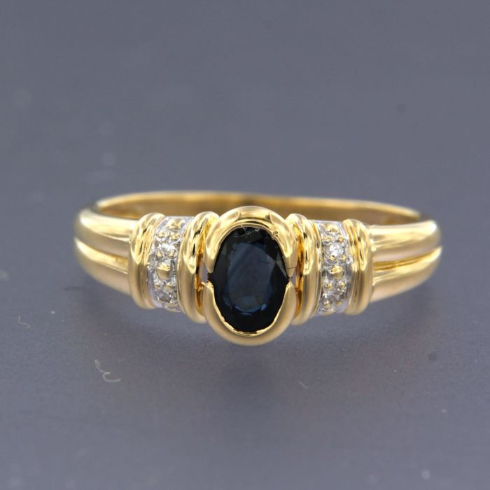 18 kt. White gold, Yellow gold - Ring - 0.65 ct Sapphire - Diamond