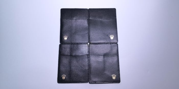 Rolex - 2x Left and 2x right crown Black card holder - mix S/N number - Unisex - 1970-1979