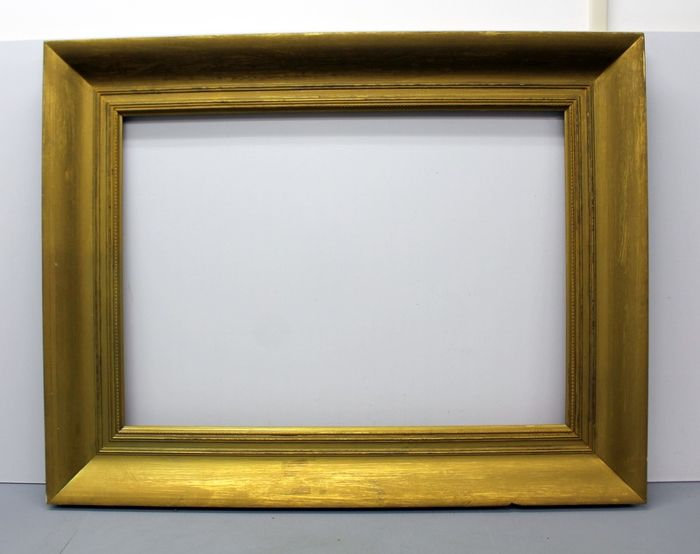 Heavy lime wood picture frame, gold gilt front with black edges.
