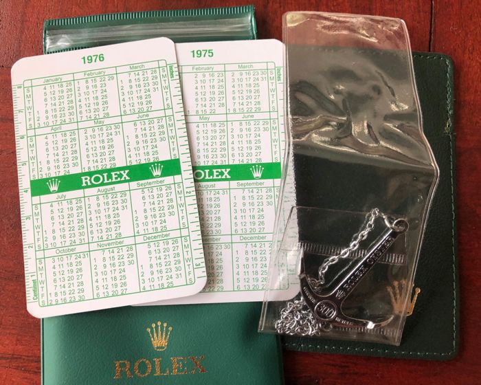 Rolex - 5x ROLEX VINTAGE ITEMS  - 2x calendars, anchor, travel pouch, guarantee card holder  - Unisex - different periods, see all photos