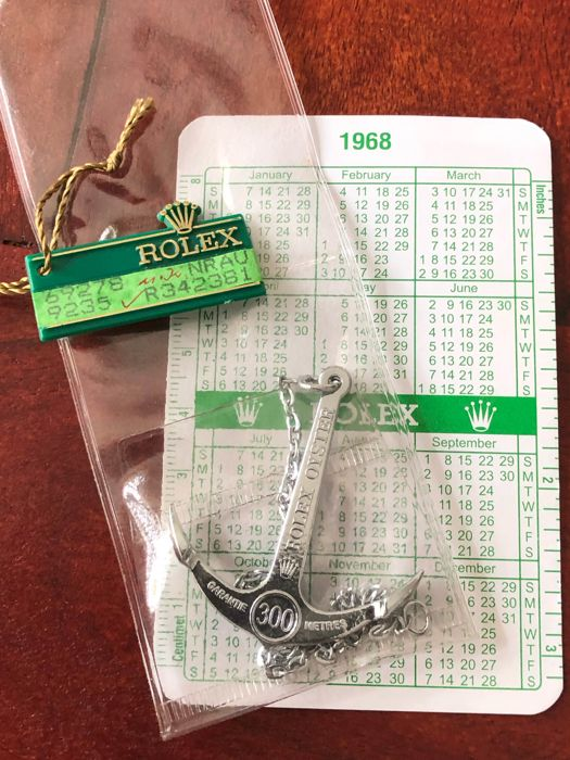 Rolex - 3x ROLEX VINTAGE ITEMS - anchor, green big crown tag, calendar  - Unisex - different periods, see all photos