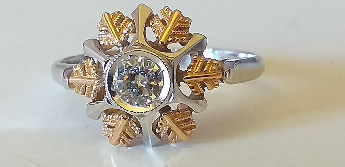 18 kt. White gold, Yellow gold - Ring - 0,22 ct Diamond