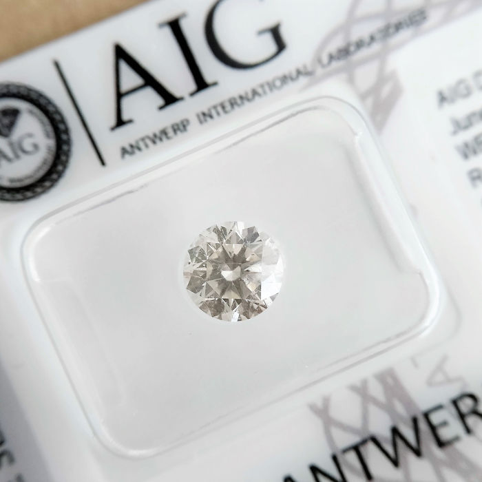 1 pcs Diamant - 1.04 ct - Brillant - H - SI1
