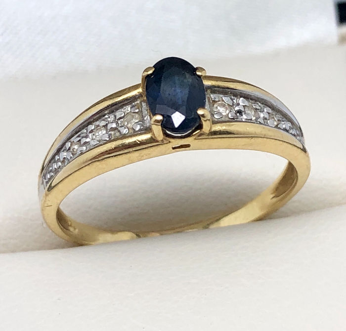 18 kt. White gold, Yellow gold - Ring - 0.60 ct Sapphire - Diamonds