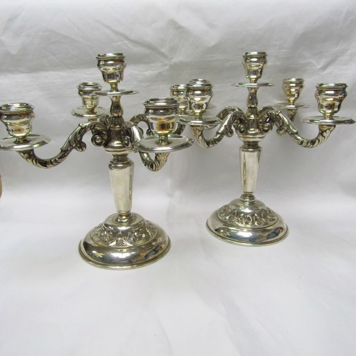 MONTEJO. Pair of five lights candlesticks. - .915 silver - Spain - First half 20th century