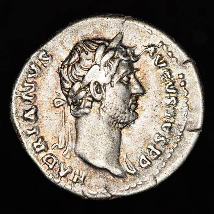 Roman Empire - Denarius - Hadrian (117 - 138 A.D.). Rome mint in 128. COS III, Victory holding wreath and palm. - Silver
