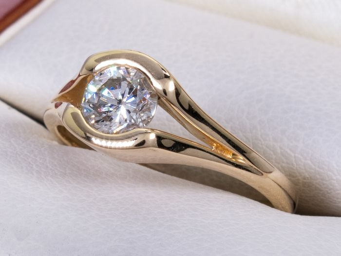 14 kt. Gold - 0.62 carat solitaire brilliant cut ring - Si1/K.