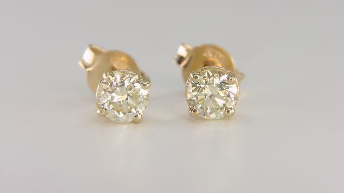 No Reserve Price - 14 kt. Yellow gold - Earrings - Clarity enhanced 0.65 ct Diamond - Natural fancy light yellow SI1!