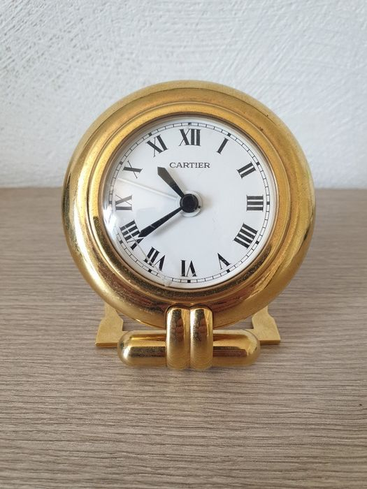 Réveil travel clock Must de Cartier, Maison Cartier Paris - Golden brass - Second half 20th century