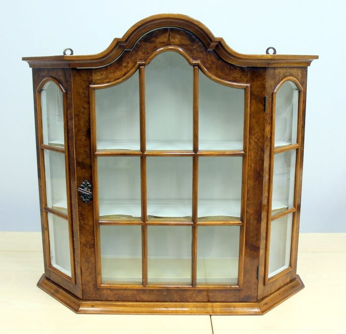 A wall display cabinet - walnut wood