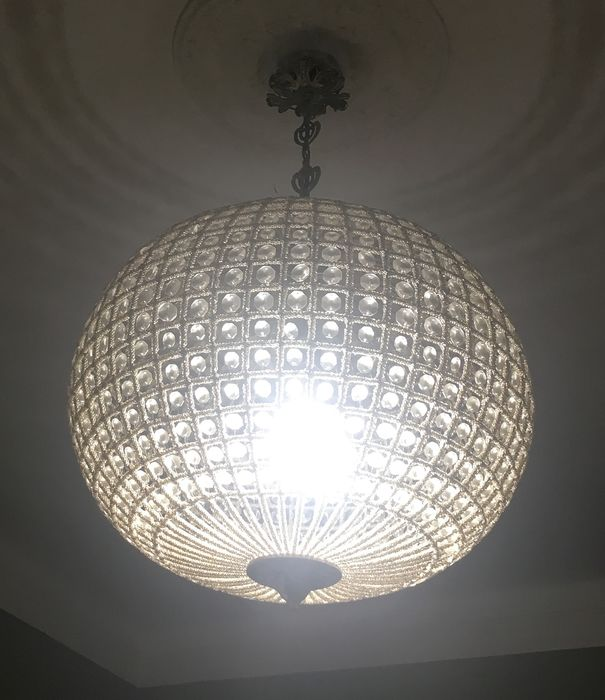 Shaped glass chandelier with a 70s silver metal frame