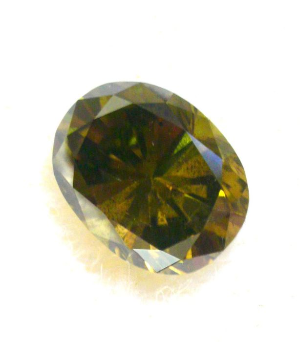 1 pcs Diamant - 1.04 ct - Oval - fancy dark grey greenish yellow - I1