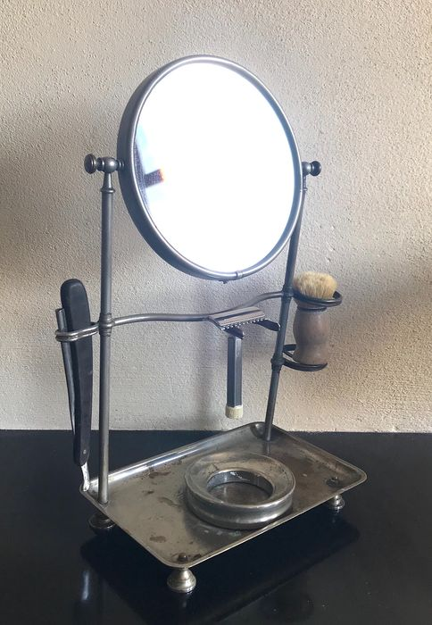 A shaving mirror with holders for brush, razor, soap, 1920s - faceted glass, metal, chromed