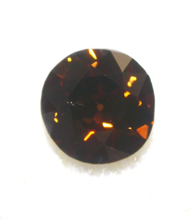 1 pcs Diamond - 0.70 ct - Circular brillant - fancy dark orange brown - VS2, cognac