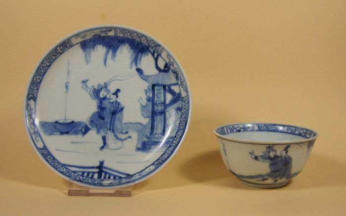 Beker, Schotel (2) - Blauw en wit - Porselein - A blue and white tea bowl and saucer from the 'Ca Mau' ship wreck, ca 1725 - China - Yongzheng (1723-1735)