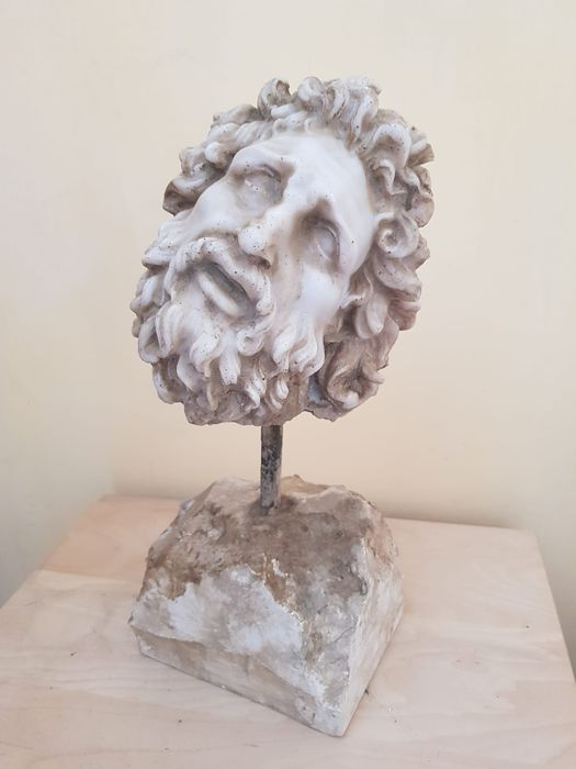 Sculpture, Head of a laocoon early in the 20th century.