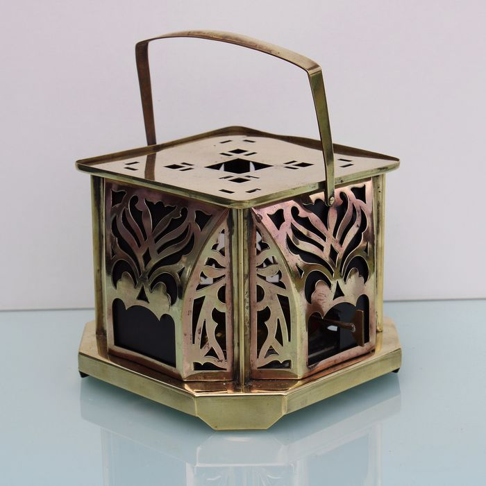 Art nouveau brass tea warmer.