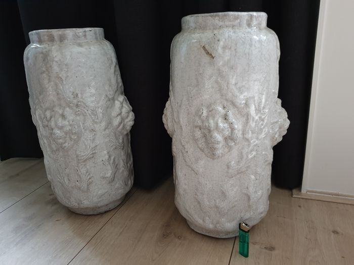 Two Flinke Vases decorated with four lion heads