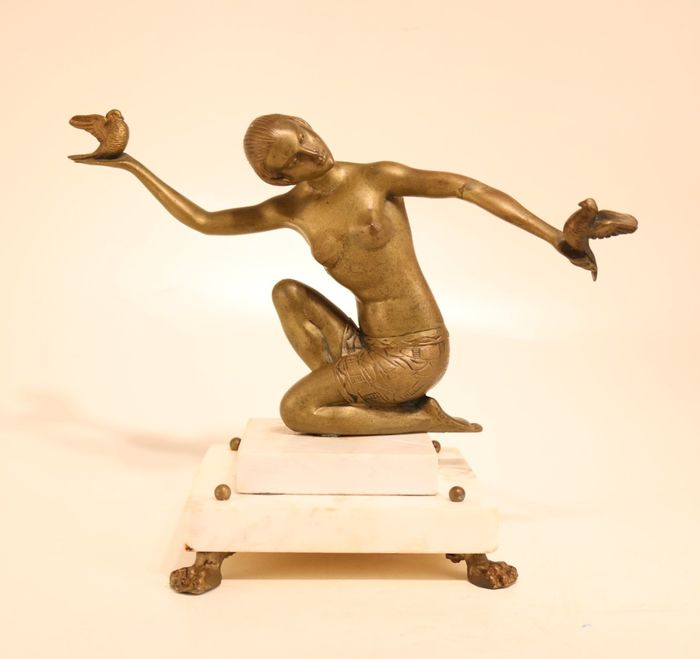 Bronze Art Deco statue sitting nude with pigeons