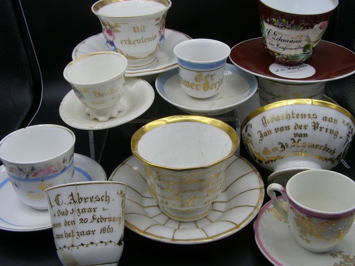 7 cups and saucers and 1 small bowls with text - Porcelain