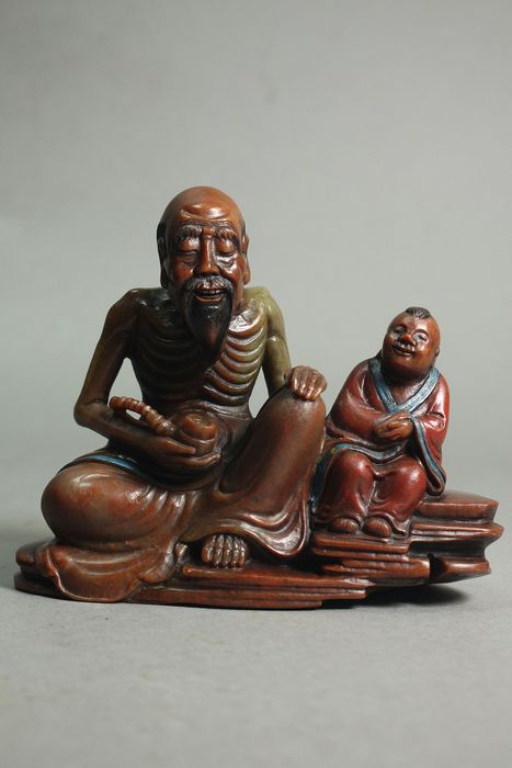 A sage with a boy - Soapstone - China - Late 20th century