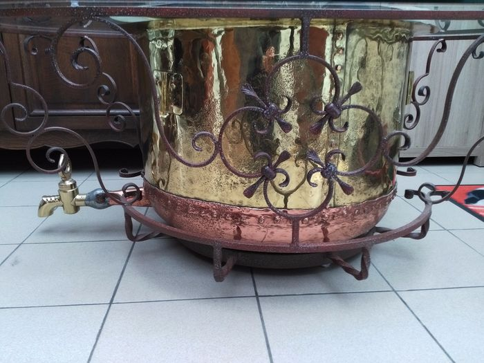 Oval glass coffee table on copper kettle and mobile decorative steel frame. - Copper, Glass, Steel