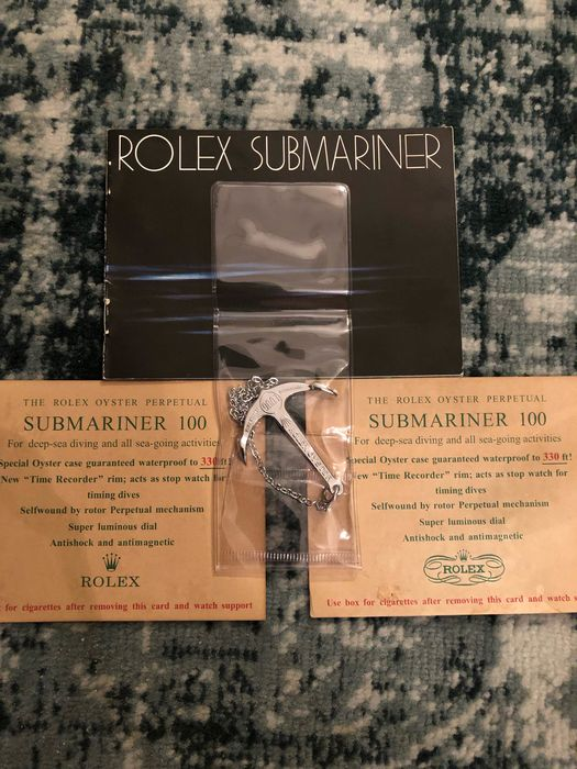 Rolex - 4x ROLEX SUBMARINER VINTAGE ITEMS  - booklet, 2x cigarette card, anchor 300m-1000ft - Unisex - different years all 4, see photos
