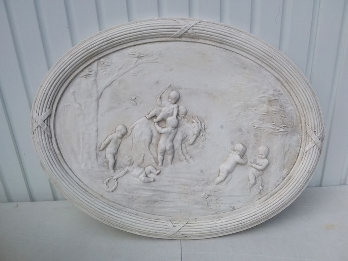 Oval plaster wall plate. - plaster