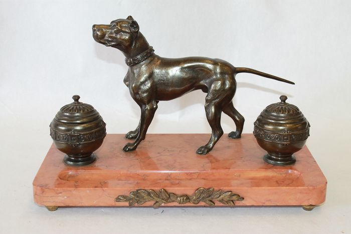 large ink set with a dog sculpture