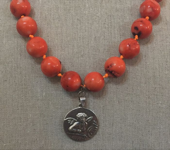 Silver medallion with the image of an angel - with a large pink coral necklace, with 925 silver.