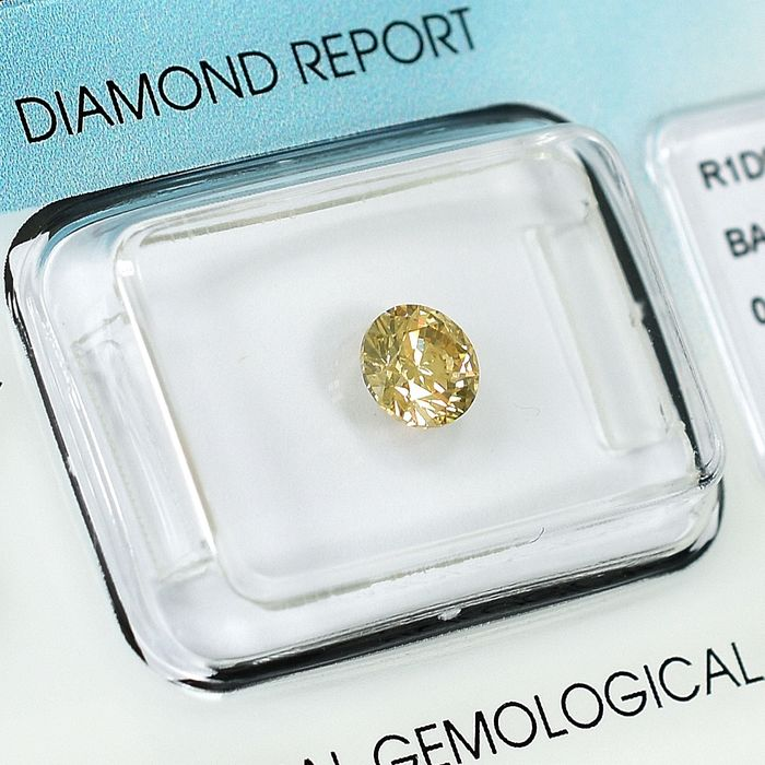 Diamond - 0.61 ct - Brilliant - Natural Fancy Light Orange - Yellow - SI1