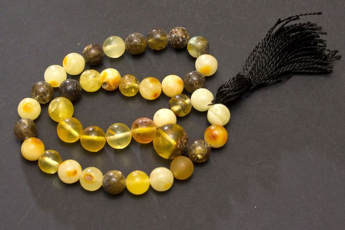 33 Runde Perlen, yellow, brown, transparent - Rosary (1) - Art Deco - Amber