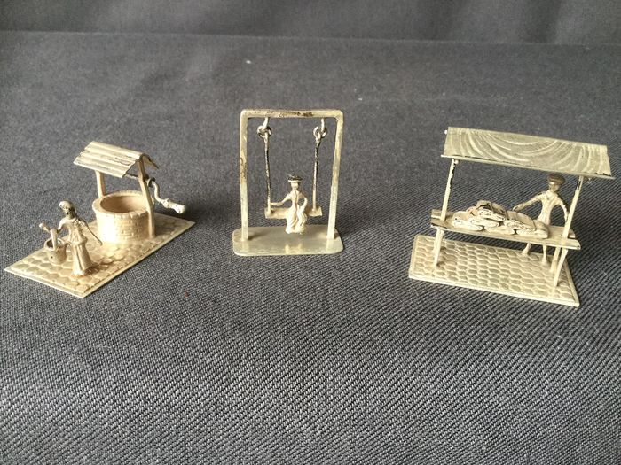 Beautiful 3 silver miniatures among others. Lady at water well, Rocked lady and Market vendor - branded (3) - .800 silver