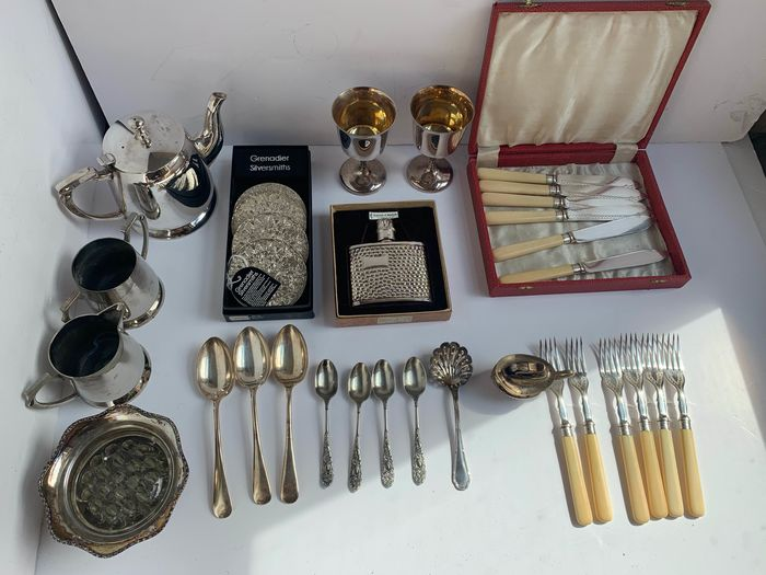 large collection of silver plated item include  tea set and fish cutlery tea spoon and wiskey bottel and more  (32) - Silverplate