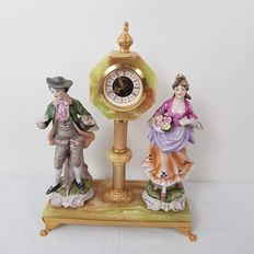 West Germany clock with porcelain man and woman -porcelain, brass
