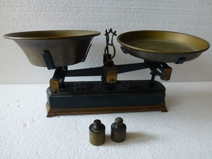 Old balance scales together with weights - copper, iron