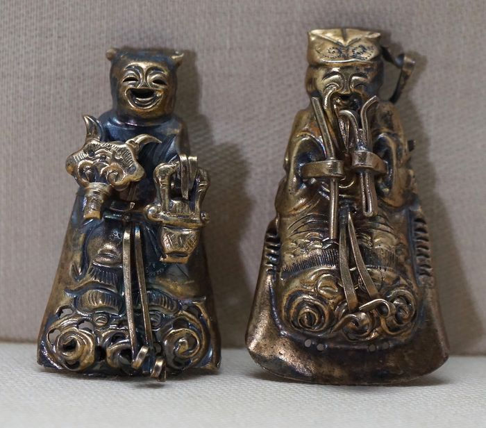 Hat ornament  (2) - Metal - Man and lady with ruyi and flower basket - China - Late 19th century