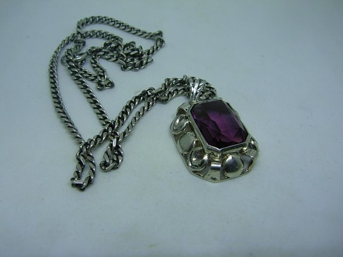 Silver - Necklace with a pendant with a purple jewel