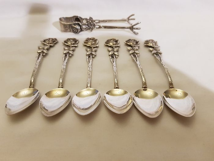 6 teaspoons with floral pattern and a sugar tongs (7) - .835 silver - Christoph Widmann - Germany - Second half 20th century