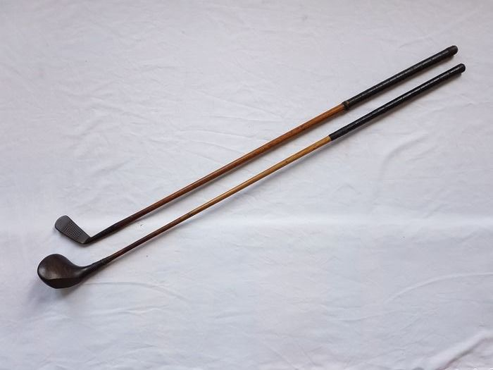 Two vintage golf clubs, wood & iron - Hickory wooden shafts with original leather grip
