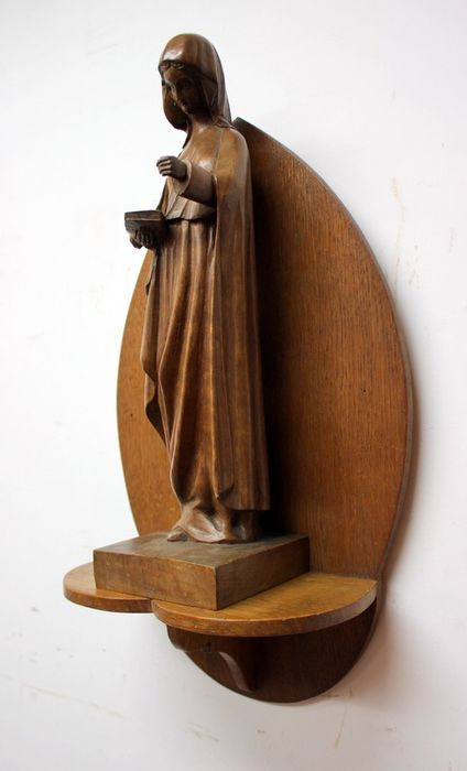 Hand-carved Mary image on wall console - Wood